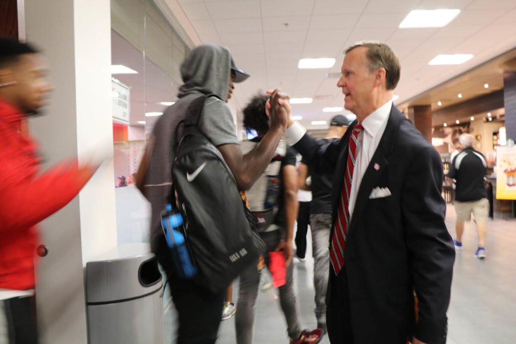 President Randell high-fives students leaving the auditorium at DSU.  Photo by Veronica Clephas.