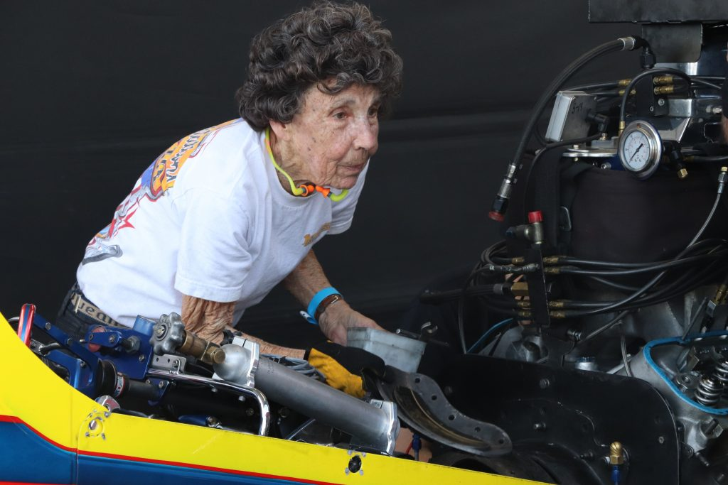 """Alison Lee, one of the nation's top rated car tuners, works on """"Great Expectations III"""" at the Holley National Hot Rod Reunion.  Photo by: Gwen Hatcher/Bowling Green High School"""