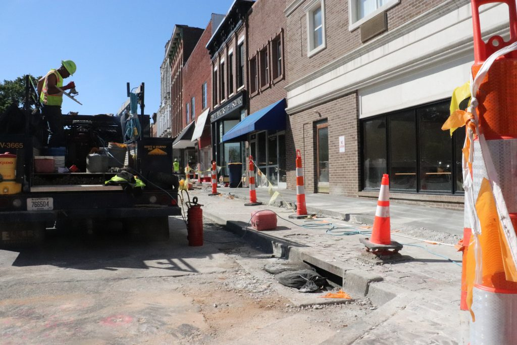 Construction takes place in the square to improve the sidewalks.  Photo By Henri Aboah/Louisville Male High School